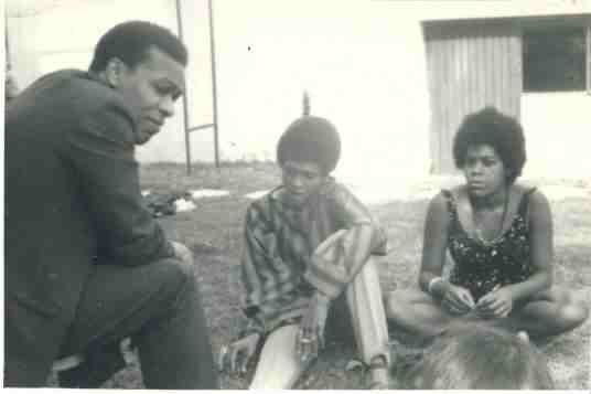 Jay Wright, poet and BI teacher, with Danier Toolsie (right) and sister(?), 1968